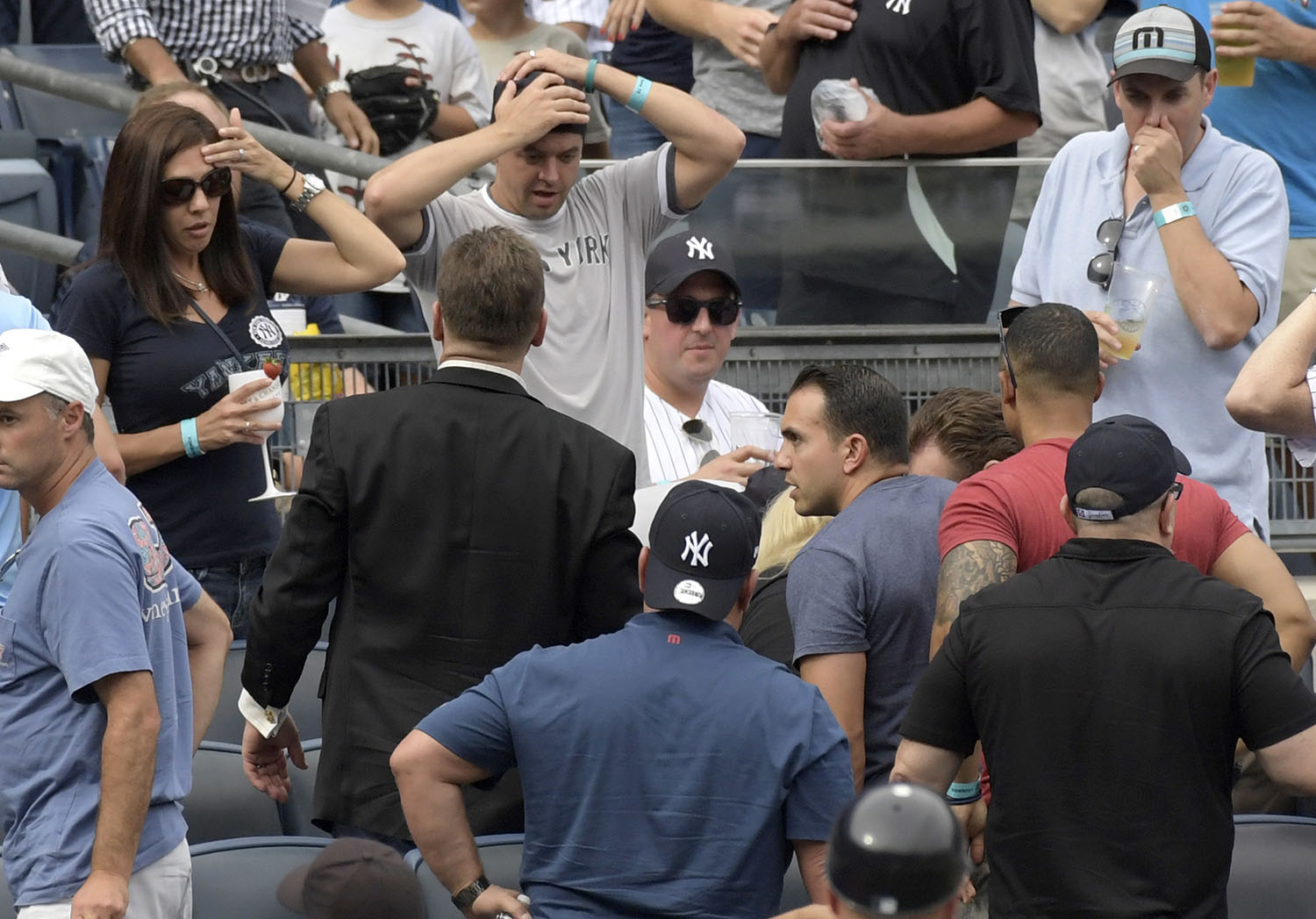 <div class='meta'><div class='origin-logo' data-origin='AP'></div><span class='caption-text' data-credit='AP Photo/Bill Kostroun'>Baseball fans react as a young girl is carried out of the seating area after being hit by a line drive during the fifth inning of a baseball game between the Yankees and Twins.</span></div>