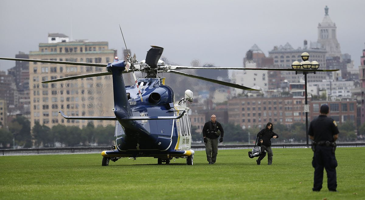 <div class='meta'><div class='origin-logo' data-origin='AP'></div><span class='caption-text' data-credit='AP Photo/Julio Cortez'>Emergency officials arrive by helicopter at Pier A Park near the Hoboken Terminal following a train crash, Thursday, Sept. 29, 2016, in Hoboken, N.J.</span></div>