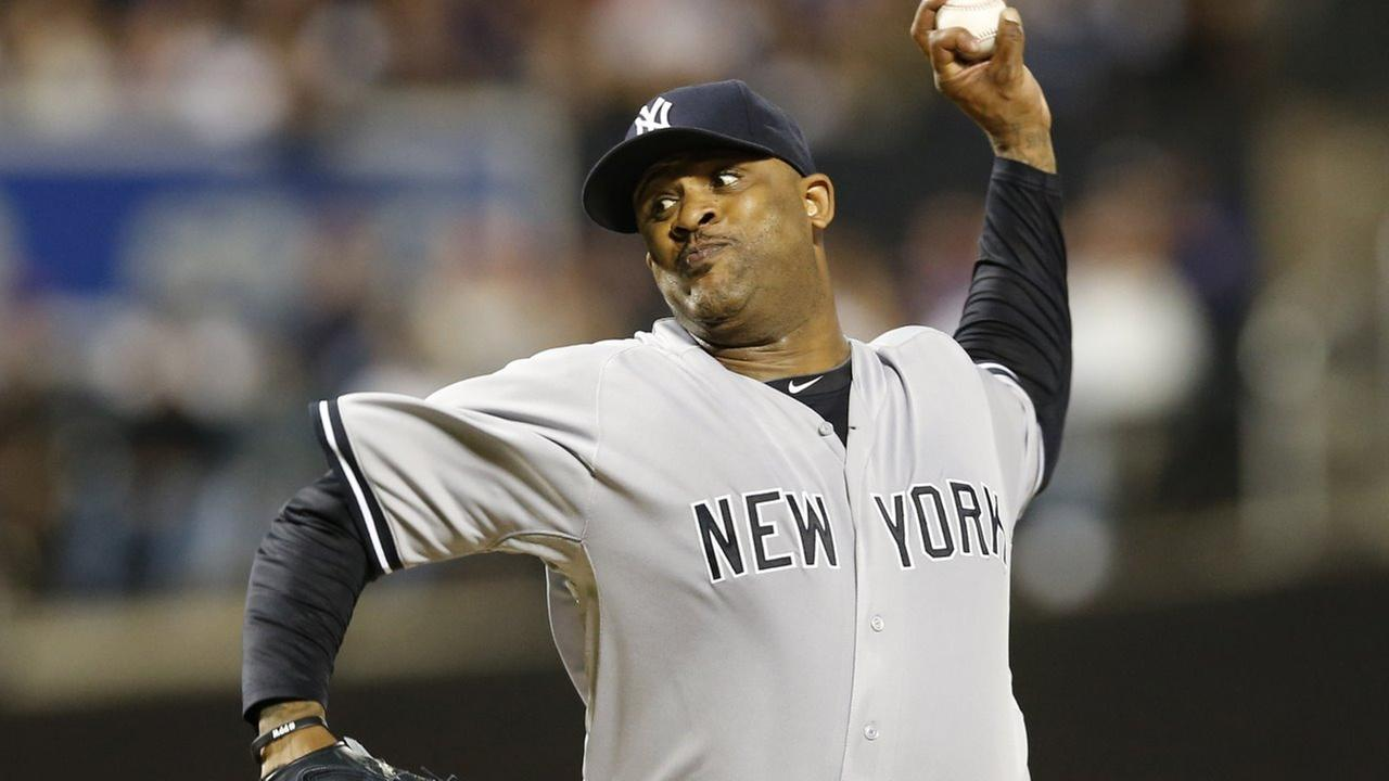 New York Yankees starting pitcher CC Sabathia delivers in the first inning of a baseball game against the New York Mets in New York, Sunday, Sept. 20, 2015.