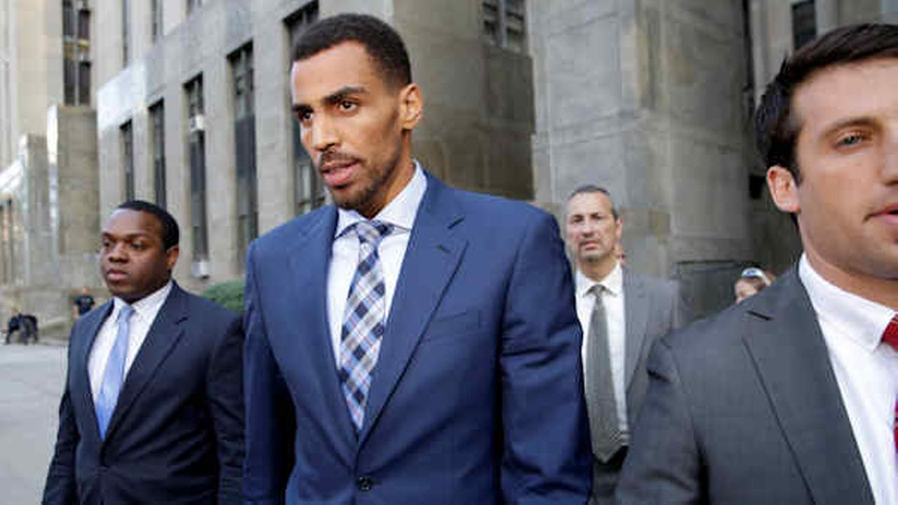 Thabo Sefolosha, second from left, leaves criminal court in New York, Wednesday, Oct. 7, 2015.
