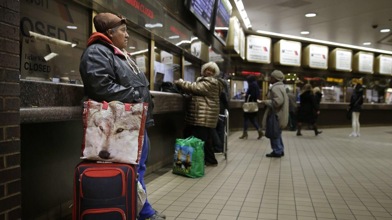 People line up to buy tickets at the Port Authority Bus Terminal in New York, Thursday, March 19, 2015.