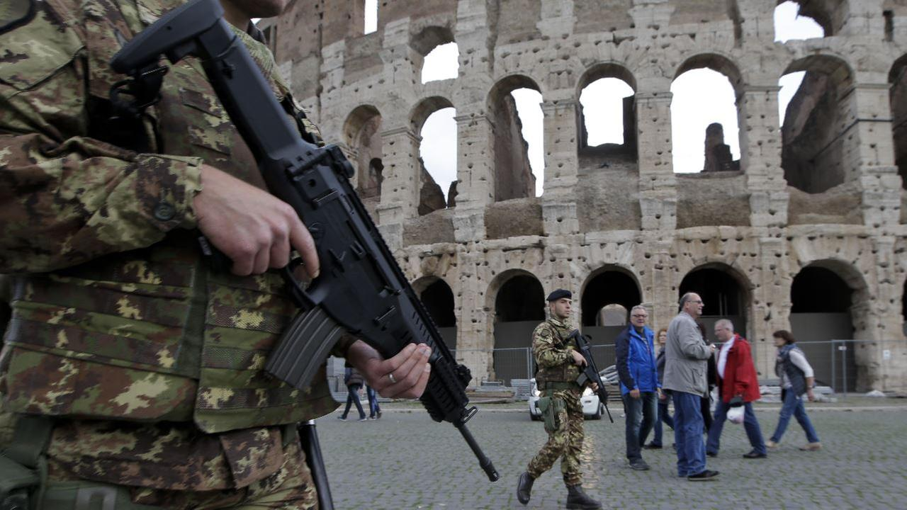Italian soldiers patrol near Romes Colosseum, Friday, Nov. 20, 2015. The State Department is warning that St. Peters Basilica in Rome, Milans cathedral and La Scala opera house.