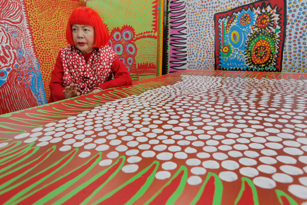<div class='meta'><div class='origin-logo' data-origin='AP'></div><span class='caption-text' data-credit='AP Photo/Itsuo Inouye'>In this photo taken Wednesday, Aug. 1, 2012, Yayoi Kusama speaks during an interview at her studio, filled with wall-sized paintings throbbing with her repetitive dots, in Tokyo.</span></div>