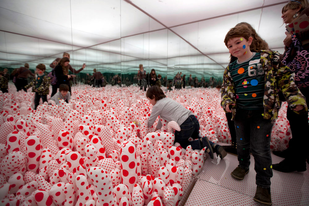 <div class='meta'><div class='origin-logo' data-origin='AP'></div><span class='caption-text' data-credit='AP Photo/Natacha Pisarenko'>Children enjoy an art installation that is part of the exhibition &#34;Infinite Obsession&#34; of Yayoi Kusama at the Malba Art Museum in Buenos Aires, Argentina, Monday, July 15, 2013.</span></div>
