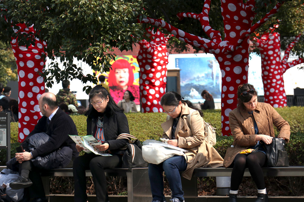"<div class=""meta image-caption""><div class=""origin-logo origin-image ap""><span>AP</span></div><span class=""caption-text"">Visitors rest outside the New National Art Center where an exhibition of Japanese artist Yayoi Kusama is being held in Tokyo Sunday, March 19, 2017. (AP Photo/Shizuo Kambayashi)</span></div>"
