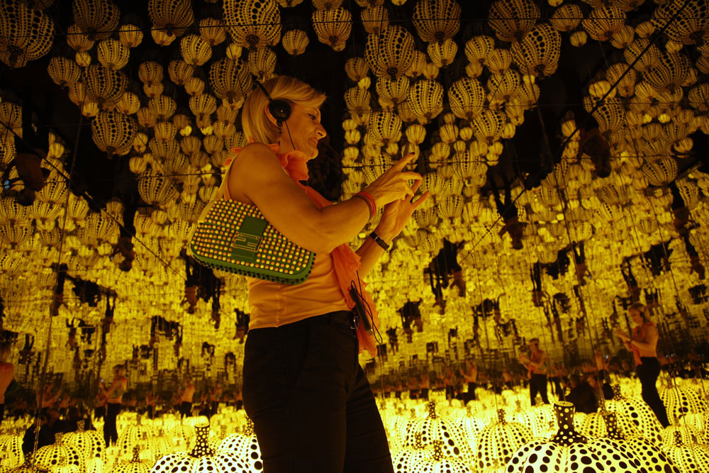 "<div class=""meta image-caption""><div class=""origin-logo origin-image ap""><span>AP</span></div><span class=""caption-text"">A woman walks past the work "" All the eternal love i have for the pumpkins "" by Yayoi Kusama in Rome, Wednesday Sept. 28, 2016. (AP Photo/Domenico Stinellis)</span></div>"