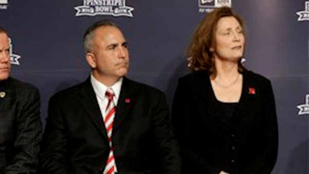 Former Rutgers football coach Kyle Flood and athletic director Julie Hermann at news conference in 2013. (AP Photo/Seth Wenig)
