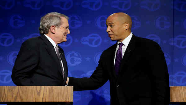 """<div class=""""meta image-caption""""><div class=""""origin-logo origin-image """"><span></span></div><span class=""""caption-text"""">Democratic incumbent Cory Booker (right) faces Jeff Bell (left) in today's New Jersey senatorial race.</span></div>"""