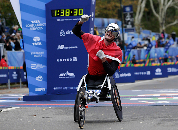 <div class='meta'><div class='origin-logo' data-origin='AP'></div><span class='caption-text' data-credit=''>Marcel Hug of Switzerland reacts after crossing the finish line first in the men's wheelchair division of the New York City Marathon in New York. (AP Photo/Seth Wenig)</span></div>