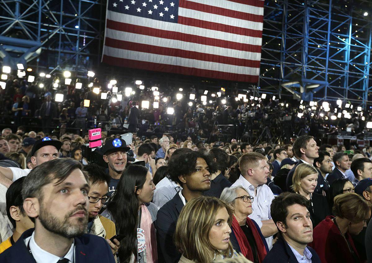 <div class='meta'><div class='origin-logo' data-origin='AP'></div><span class='caption-text' data-credit='AP Photo/Frank Franklin II'>Supporters watch election results during Democratic presidential nominee Hillary Clinton's election night rally in the Jacob Javits Center glass enclosed lobby in New York.</span></div>