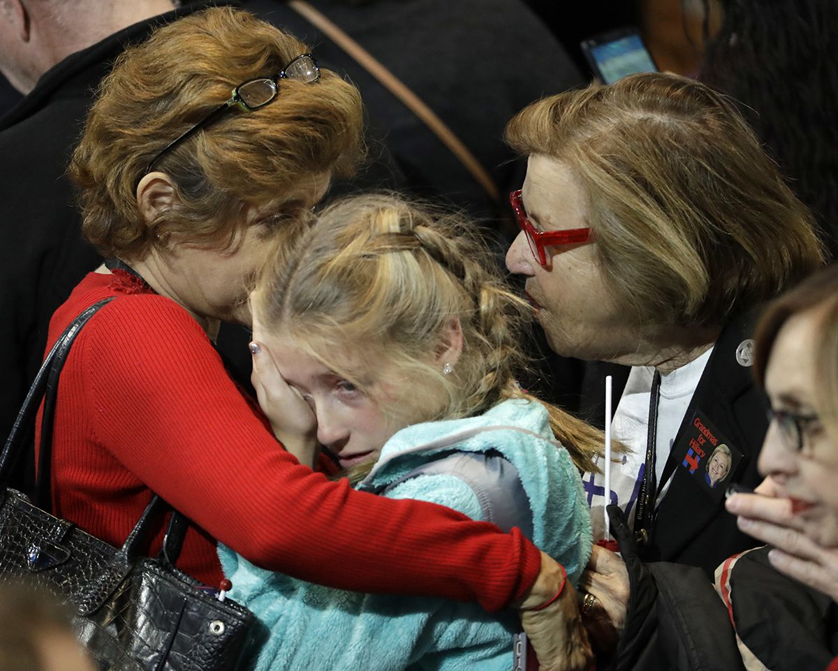 <div class='meta'><div class='origin-logo' data-origin='AP'></div><span class='caption-text' data-credit='AP Photo/David Goldman'>A young girl is comforted during Democratic presidential nominee Hillary Clinton's election night rally in the Jacob Javits Center.</span></div>
