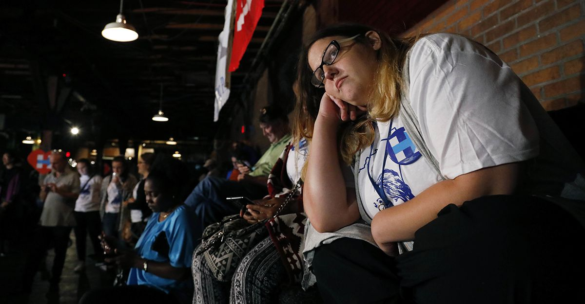 "<div class=""meta image-caption""><div class=""origin-logo origin-image ap""><span>AP</span></div><span class=""caption-text"">Stephanie Baile, intern for Democratic presidential candidate Hillary Clinton, watches the growing number of national votes for Republican Donald Trump on Tuesday evening. (AP Photo/Rogelio V. Solis)</span></div>"