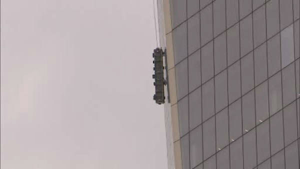"""<div class=""""meta image-caption""""><div class=""""origin-logo origin-image """"><span></span></div><span class=""""caption-text"""">Two workers became stuck on scaffolding hanging from 1 World Trade.</span></div>"""