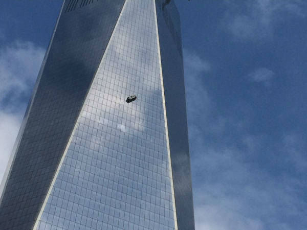 """<div class=""""meta image-caption""""><div class=""""origin-logo origin-image """"><span></span></div><span class=""""caption-text"""">Two workers became stuck on scaffolding hanging from the World Trade Center.  (Photo from ABC's Aaron Katersky.)</span></div>"""
