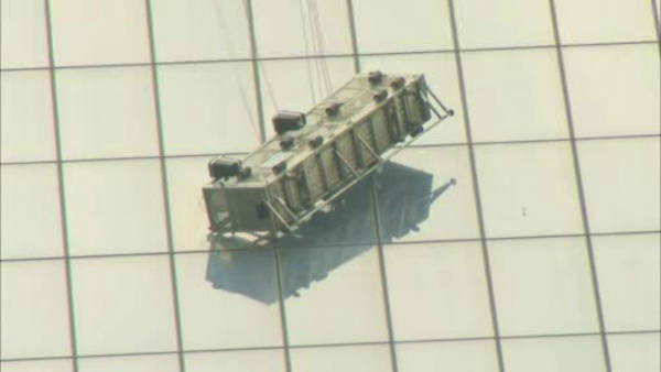 """<div class=""""meta image-caption""""><div class=""""origin-logo origin-image """"><span></span></div><span class=""""caption-text"""">Two workers became stuck on scaffolding hanging from the World Trade Center. </span></div>"""
