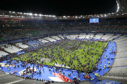 <div class='meta'><div class='origin-logo' data-origin='none'></div><span class='caption-text' data-credit='AP Photo / Michel Euler'>Spectators invade the pitch of the Stade de France stadium after the international friendly soccer France against Germany, Friday, Nov. 13, 2015.</span></div>