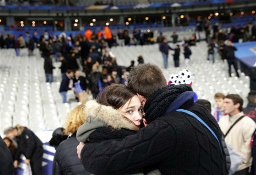 <div class='meta'><div class='origin-logo' data-origin='none'></div><span class='caption-text' data-credit='AP Photo/ Christophe Ena'>A supporter conforts a friend after invading the pitch of the Stade de France stadium at the end of the international friendly soccer match between France and Germany.</span></div>