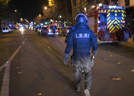 "<div class=""meta image-caption""><div class=""origin-logo origin-image none""><span>none</span></div><span class=""caption-text"">An elite police officer arrivesoutside the Bataclan theater  in Paris, France, Wednesday, Nov. 13, 2015. (AP Photo/ Kamil Zihnioglu)</span></div>"