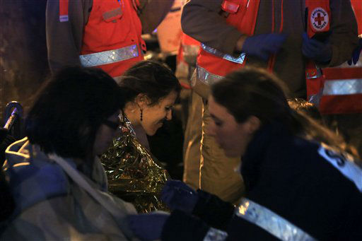 <div class='meta'><div class='origin-logo' data-origin='none'></div><span class='caption-text' data-credit='AP Photo / Thibault Camus'>People are comforted after being evacuated from the Bataclan theater after a shooting in Paris, Friday Nov. 13, 2015.</span></div>