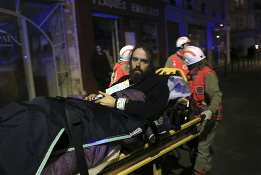 <div class='meta'><div class='origin-logo' data-origin='none'></div><span class='caption-text' data-credit='AP Photo / Thibault Camus'>A man is being evacuated from the Bataclan theater after a shooting in Paris, Friday Nov. 13, 2015.</span></div>