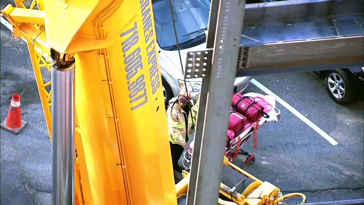 2 workers killed after beam falls onto crane at queens