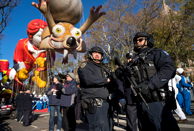 "<div class=""meta image-caption""><div class=""origin-logo origin-image ap""><span>AP</span></div><span class=""caption-text"">Heavily-armed members of the New York Police Department take a position along the route before the start of the Macy's Thanksgiving Day Parade Nov. 23,. (AP Photo/Craig Ruttle)</span></div>"