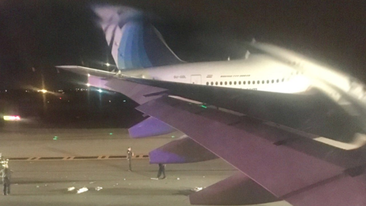 Planes damaged after wings touch at Kennedy Airport