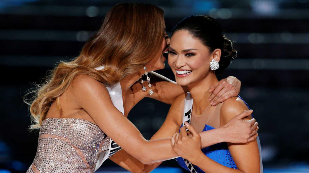 Miss Colombia Ariadna Gutierrez, left, and Miss Philippines Pia Alonzo Wurtzbach react as they make the final three at the Miss Universe pageant Sunday, Dec. 20, 2015