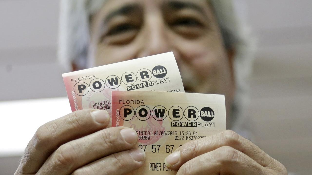Jose Garrido shows his Powerball tickets, Wednesday, Jan. 6, 2016, at a local grocery store in Hialeah, Fla.