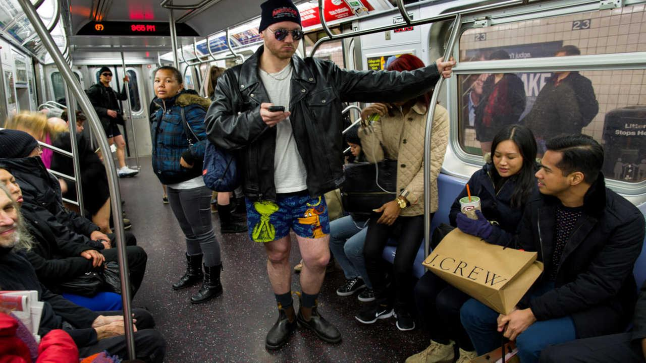 A participant not wearing pants stands on a subway train while taking part in the annual No Pants Subway Ride, Sunday, Jan. 12, 2014, in New York.
