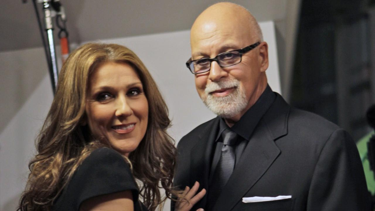 Celine Dion, left, poses with her husband Rene Angelil, right, as they arrives for the premiere of the film Celine: Through the Eyes of the World in Miami Beach, Fla.