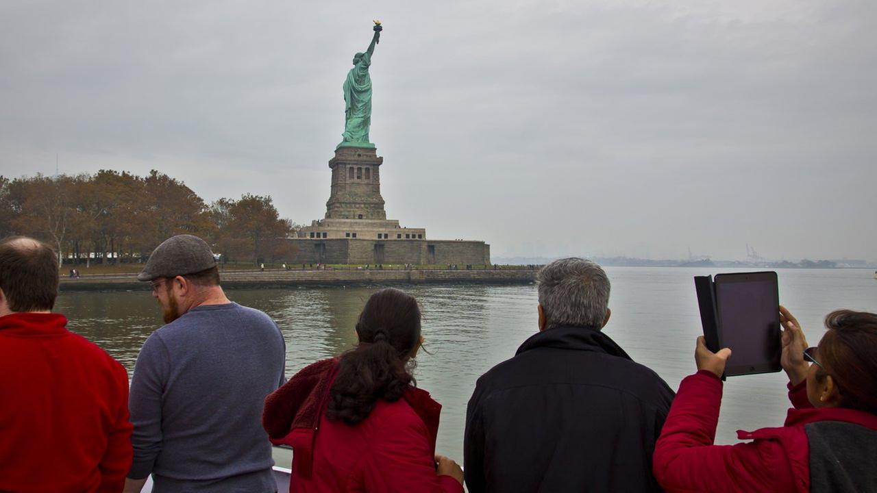 Visitors view the Statue of Liberty during a ferry ride to Liberty Island, Thursday, Nov. 5, 2015, in New York.