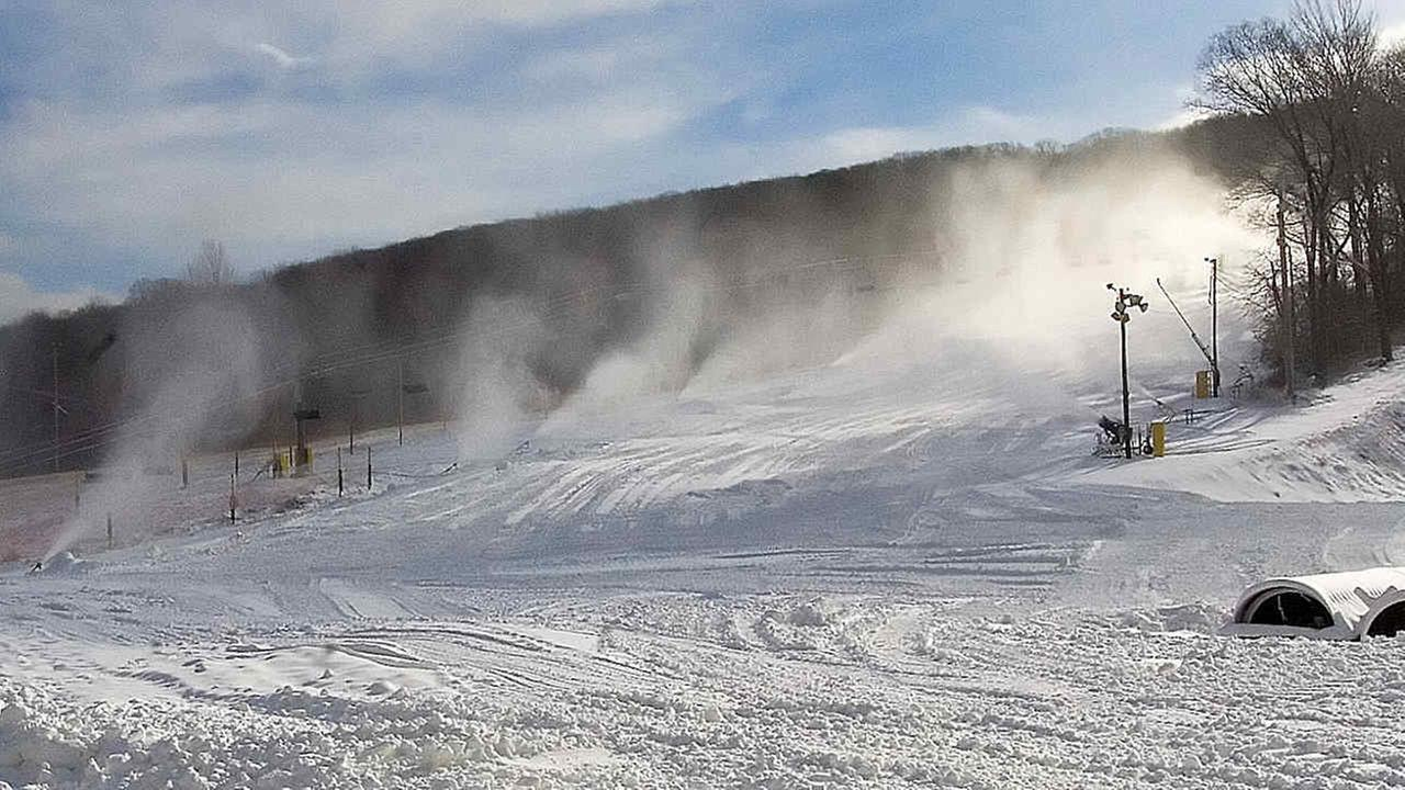 Snow guns work at Mountain Creek in Vernon, N.J., to lay a base of artificial snow for the reopening of the facility Friday, Jan. 19, 2007.