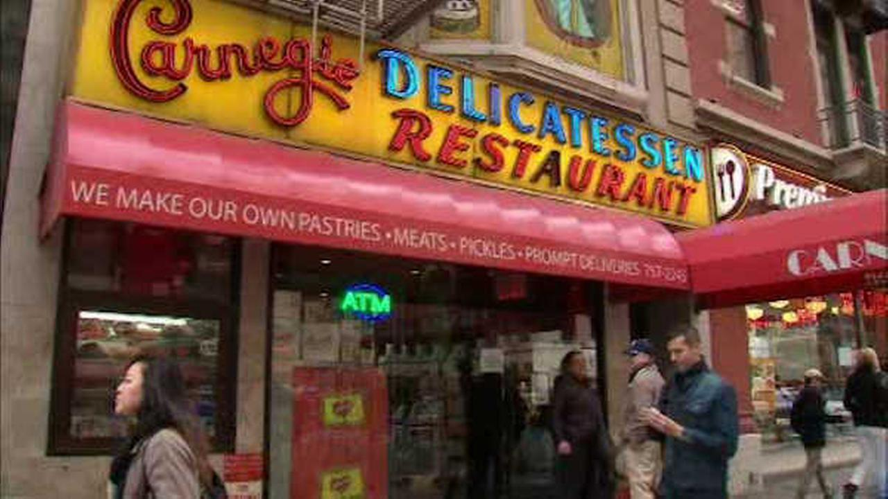 Photographs that once lined the walls of the famous Carnegie Deli left out on the curb