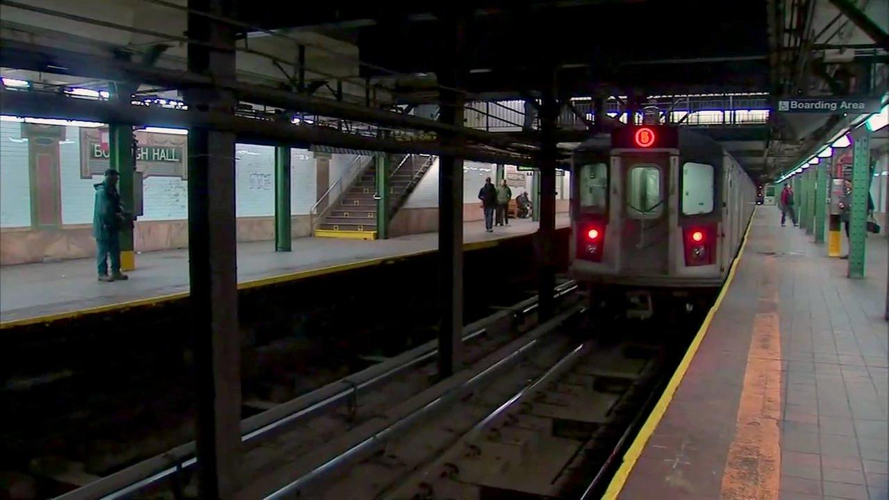 Woman fights off homeless man who tries to shove her onto Brooklyn subway tracks