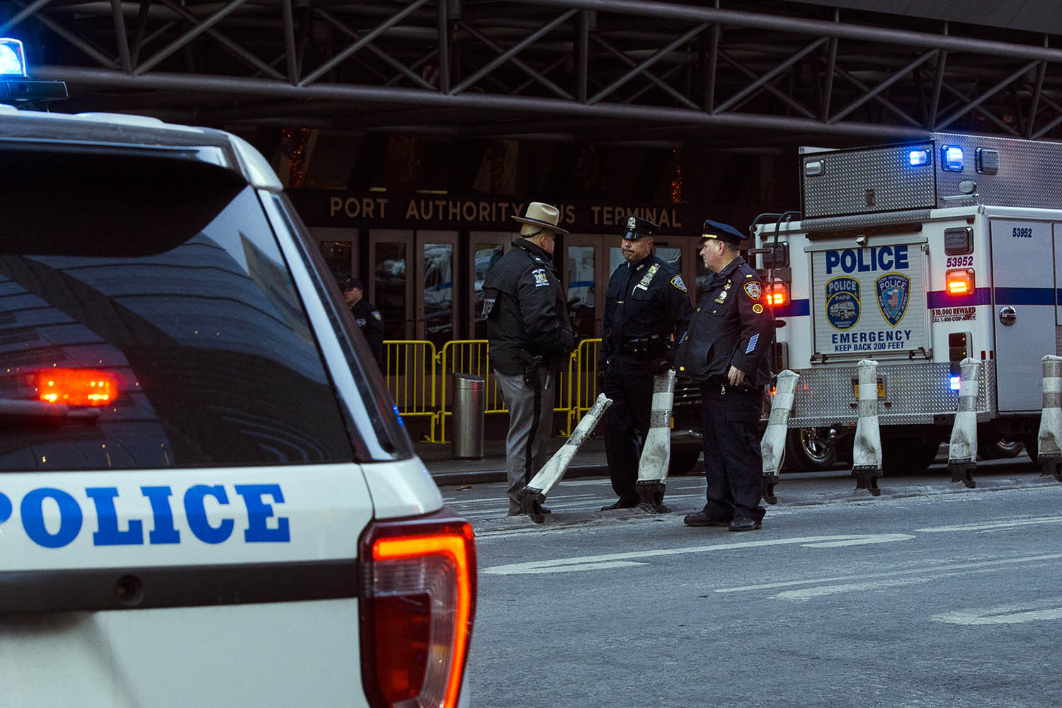 <div class='meta'><div class='origin-logo' data-origin='AP'></div><span class='caption-text' data-credit='AP Photo/Andres Kudacki'>Police stand guard in front of the Port Authority Bus Terminal near New York's Times Square following an explosion on Monday, Dec. 11, 2017.</span></div>
