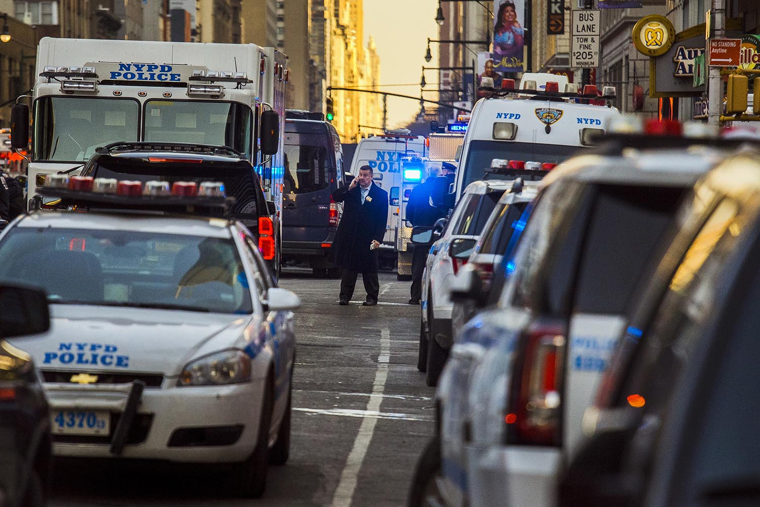 <div class='meta'><div class='origin-logo' data-origin='AP'></div><span class='caption-text' data-credit='AP Photo/Andres Kudacki'>Police block a street by Port Authority Bus Terminal near New York's Times Square following an explosion on Monday, Dec. 11, 2017.</span></div>