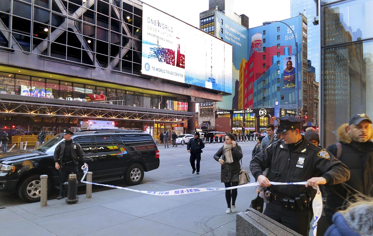 <div class='meta'><div class='origin-logo' data-origin='AP'></div><span class='caption-text' data-credit='AP Photo/Chuck Zoeller'>Police secure Eighth Avenue outside the Port Authority Bus Terminal following an explosion near New York's Times Square on Monday, Dec. 11, 2017.</span></div>