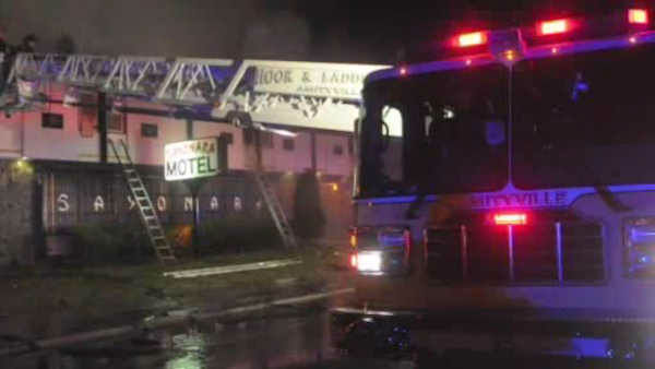 <div class='meta'><div class='origin-logo' data-origin='none'></div><span class='caption-text' data-credit=''>Firefighters battled a fire early Sunday morning at a motel in North Amityville, Long Island.</span></div>