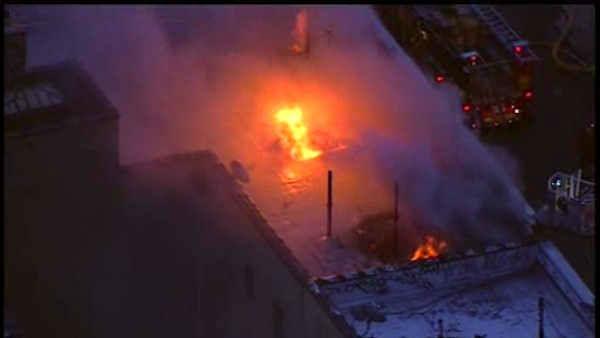 <div class='meta'><div class='origin-logo' data-origin='none'></div><span class='caption-text' data-credit=''>Firefighters battled a 5-alarm fire Thursday at an apartment building in Ozone Park, Queens.</span></div>