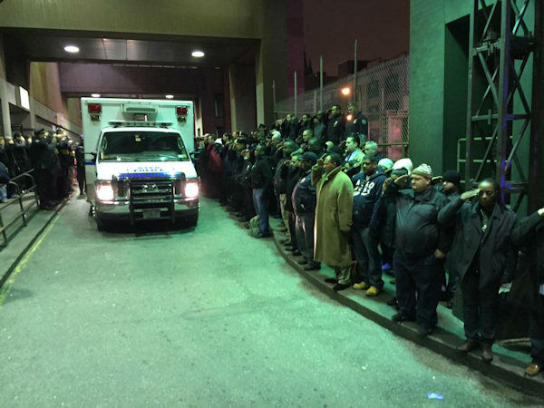 <div class='meta'><div class='origin-logo' data-origin='none'></div><span class='caption-text' data-credit=''>Hundreds of NYPD officers line streets to honor 2 fallen officers on Saturday, December 20, 2014.</span></div>