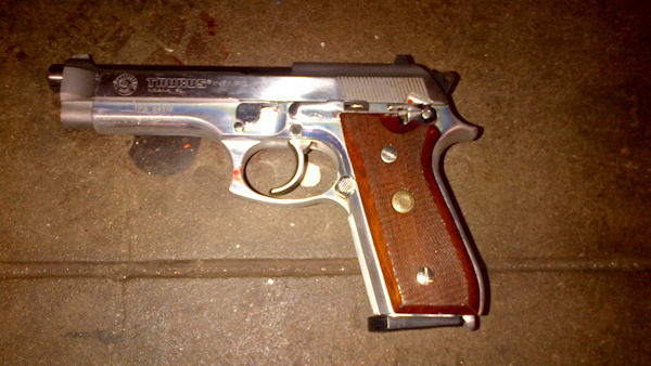 <div class='meta'><div class='origin-logo' data-origin='none'></div><span class='caption-text' data-credit=''>A silver semi-automatic Taurus firearm was recovered on the subway platform near the suspect's body.</span></div>