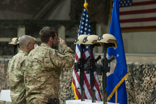 "<div class=""meta image-caption""><div class=""origin-logo origin-image none""><span>none</span></div><span class=""caption-text"">Service members from several units at Bagram Air Field, Afghanistan, pay their respects during a fallen comrade ceremony held in honor of six Airmen Dec. 23, 2015. (Photo/Tech. Sgt. Robert Cloys)</span></div>"
