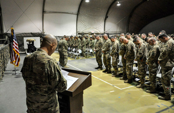 "<div class=""meta image-caption""><div class=""origin-logo origin-image none""><span>none</span></div><span class=""caption-text"">Service members from several units at Bagram Air Field, Afghanistan, pay their respects during a fallen comrade ceremony held in honor of six Airmen Dec. 23, 2015. (Photo/Tech. Sgt. Nicholas Rau)</span></div>"