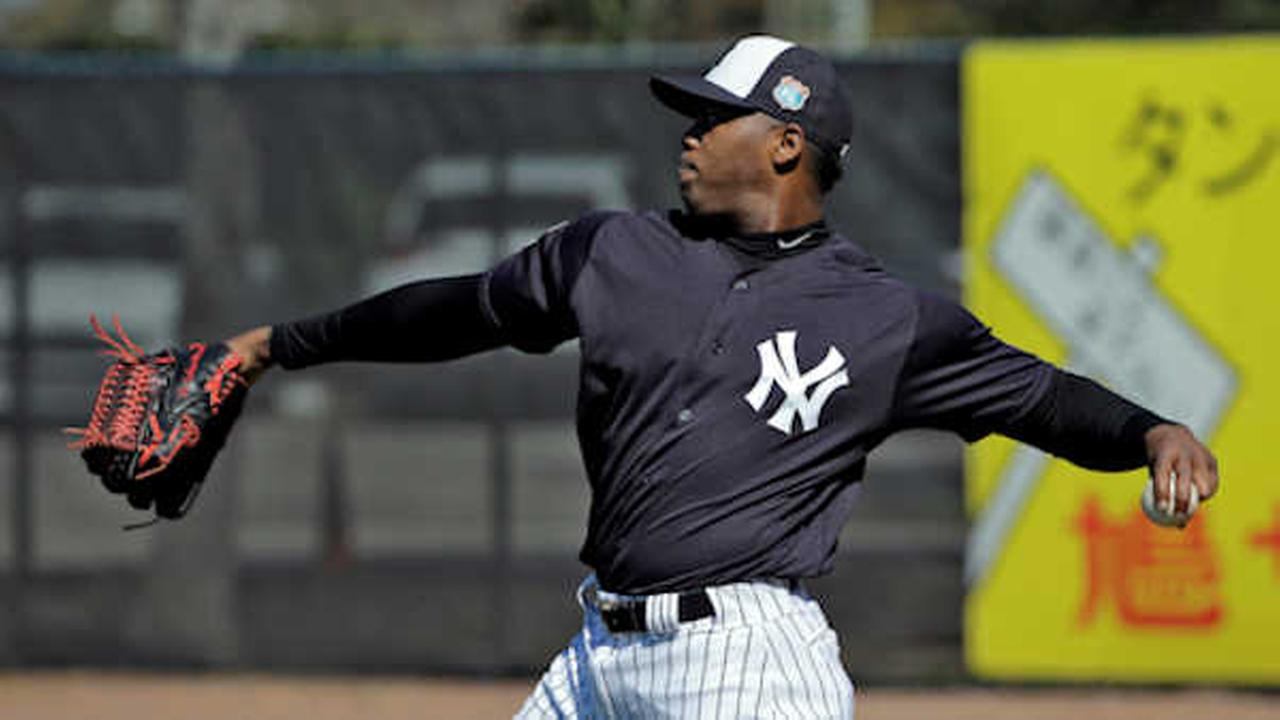 Yankees pitcher Aroldis Chapman throws during a spring training baseball workout, in Tampa, Fla.  (AP Photo/Chris OMeara)