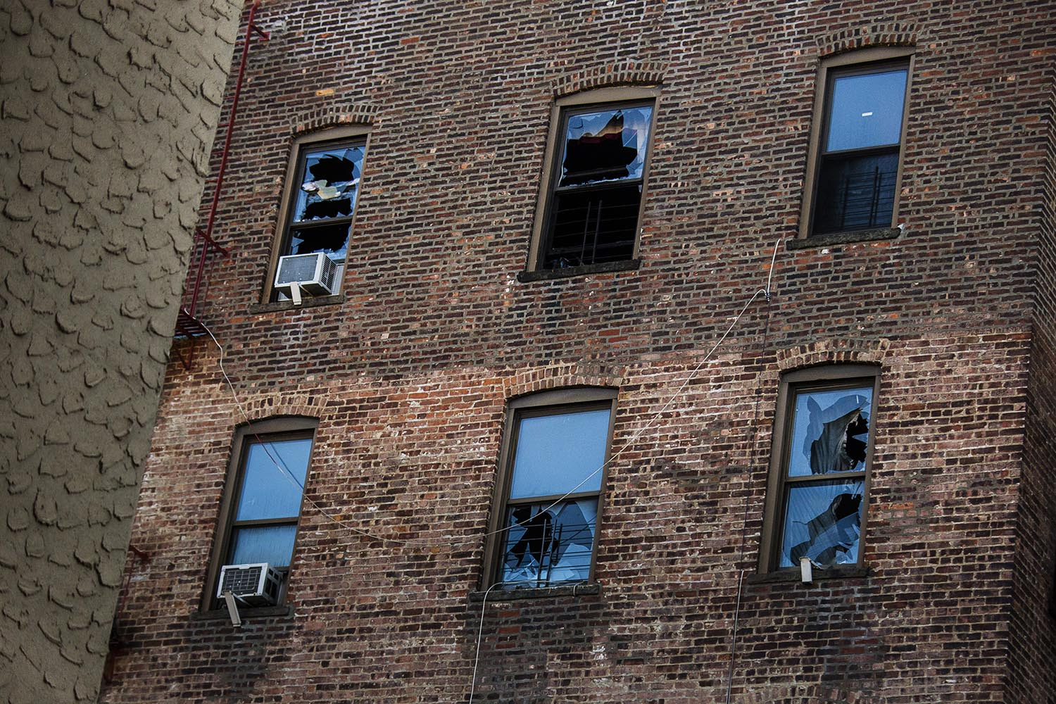<div class='meta'><div class='origin-logo' data-origin='AP'></div><span class='caption-text' data-credit='AP Photo/Andres Kudacki'>This Friday, Dec. 29, 2017, photo shows broken windows on the back of the building where more than 10 people died Thursday in a fire in the Bronx borough of New York.</span></div>