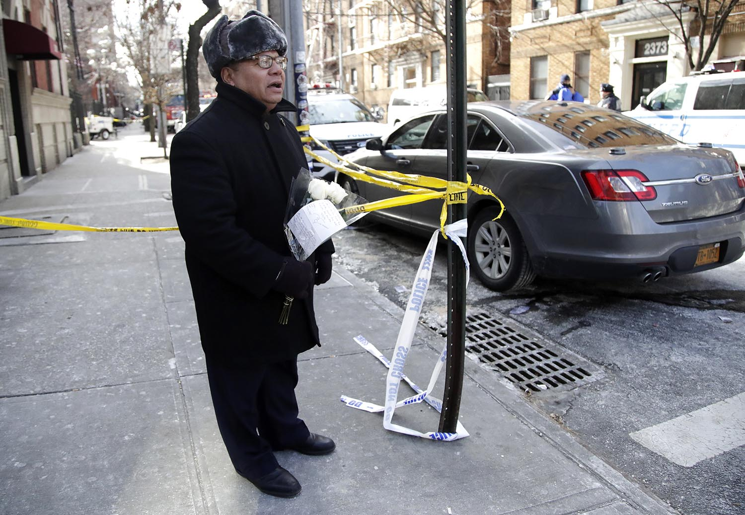 <div class='meta'><div class='origin-logo' data-origin='AP'></div><span class='caption-text' data-credit='AP Photo/Julio Cortez'>Juan I. Sanchez waits for officials to let him drop off flowers at the site of a deadly fire in the Bronx, Friday, Dec. 29, 2017.</span></div>