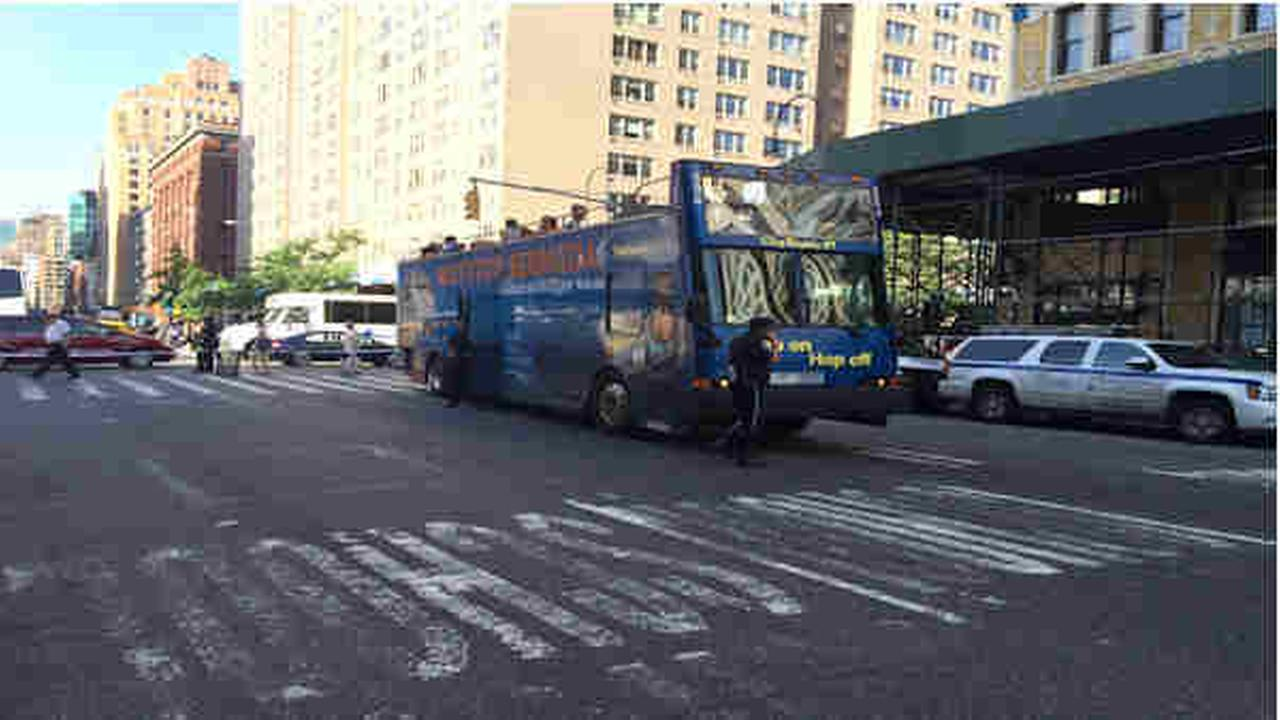 Woman hit by tour bus on West 14th Street.