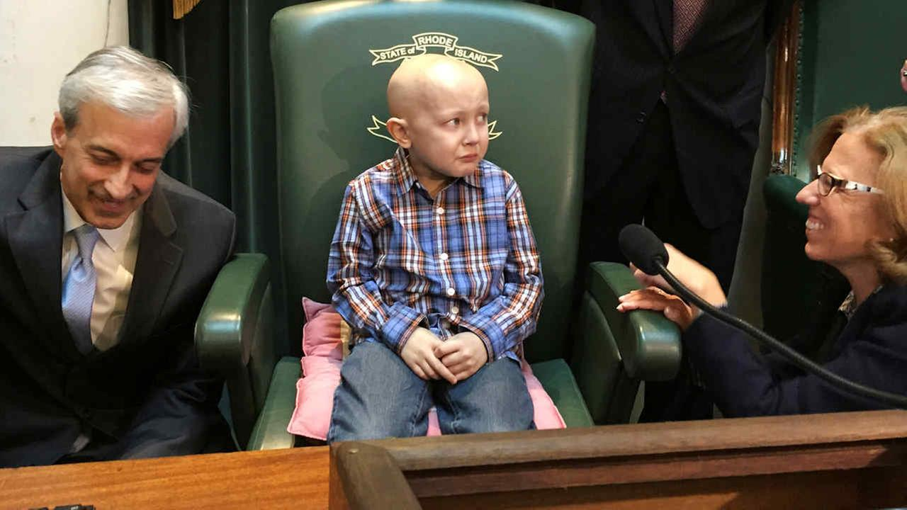Dorian Murray, 8, sits in the Senate Chamber as he is honored by Rhode Island lawmakers