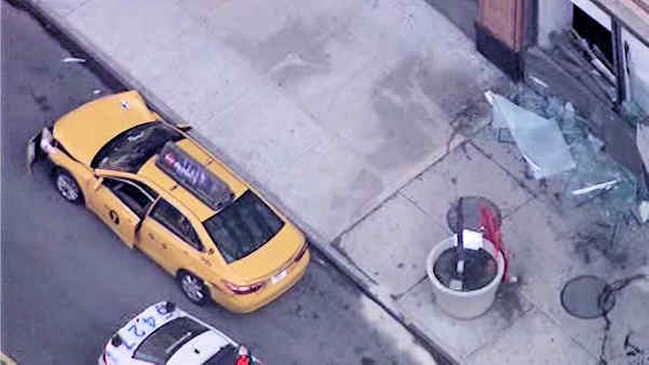 3 hurt when taxi jumps curb, slams into Manhattan building